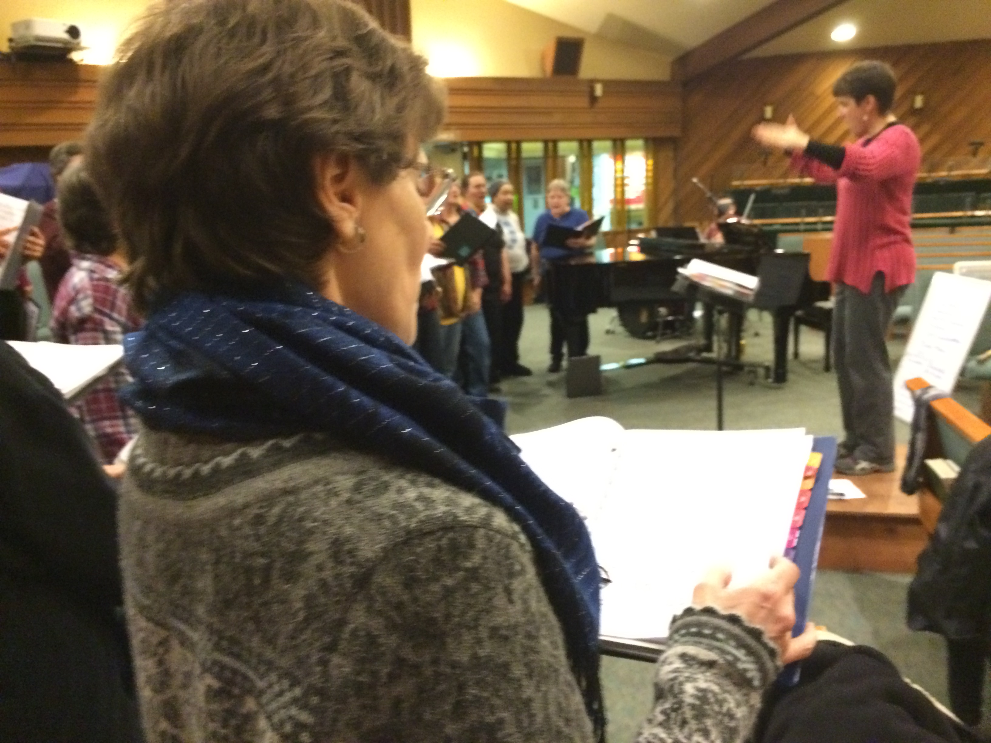 Juneau Pride Chorus member Janet Schempf at Tuesday's rehearsal. (Photo by Scott Burton/KTOO)