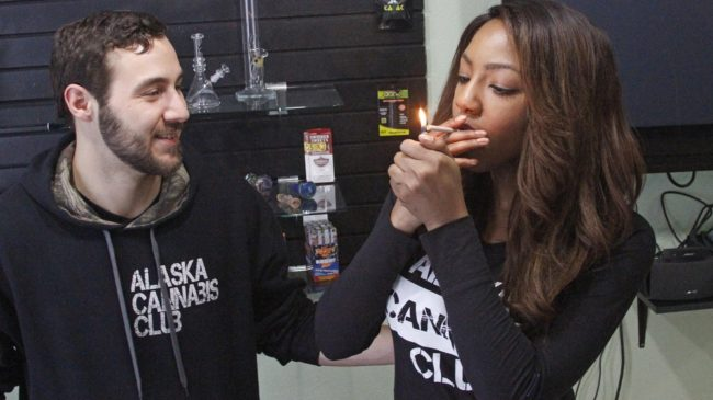 Leaders of the Alaska Cannabis Club share a joint at their medical marijuana dispensary in Anchorage. On Tuesday, Alaska became the third state in the nation to legalize recreational marijuana use. Mark Thiessen/AP