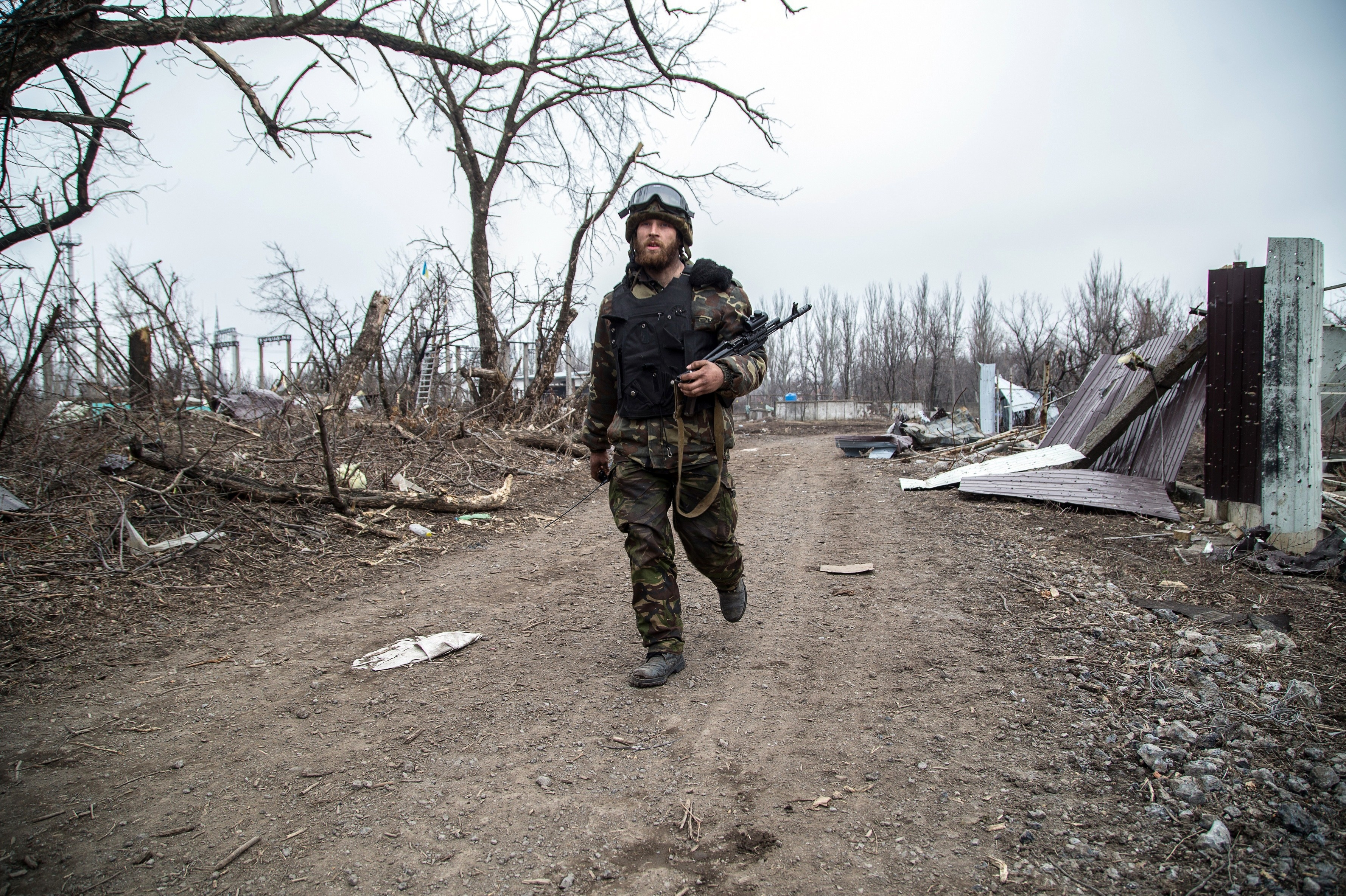 A Ukrainian serviceman walks in the village of Pisky in the region of Donetsk controlled by Ukrainian forces on Feb. 26. Oleksandr Ratushniak/AFP/Getty Images