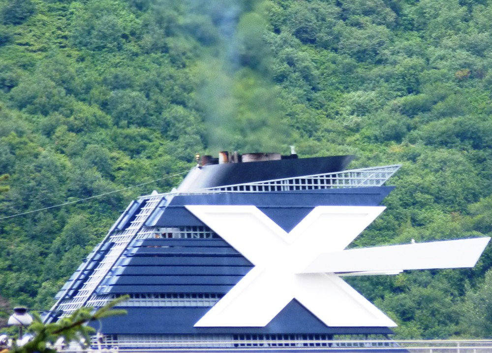 A Celebrity Cruise Line ship sails into Juneau in 2012 with emissions coming out of its stack. New pollution-control equipment will reduce the plume. (Ed Schoenfeld/CoastAlaska News)
