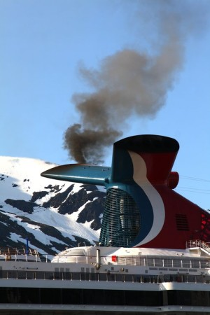 Smoke pours out of the smokestack of the Carnival Spirit cruise ship as it fires up its engines. (Courtesy Ground Truth Trekking)