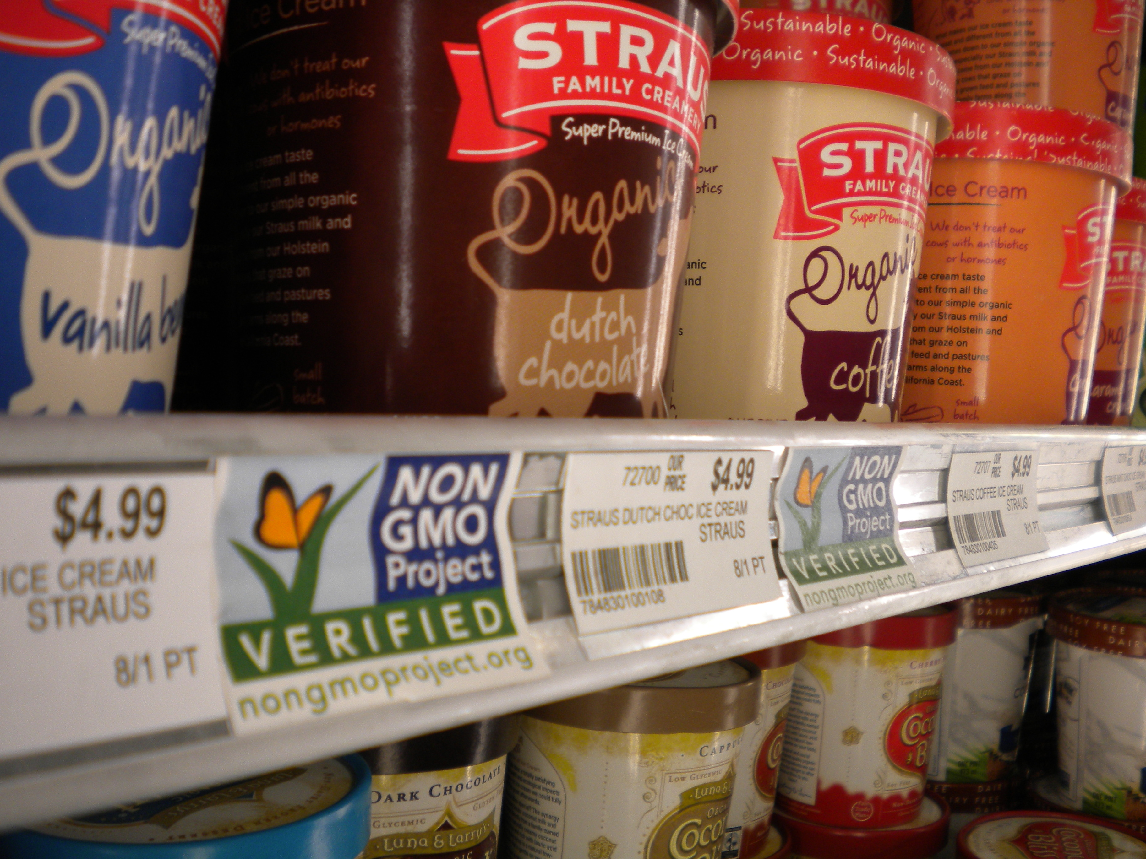 Rainbow Foods in downtown Juneau labels while products and do not contain genetically-modified organisms. House Bill 92 aims to require all foods sold in Alaska to have such labels. (Photo by Kevin Reagan / KTOO)