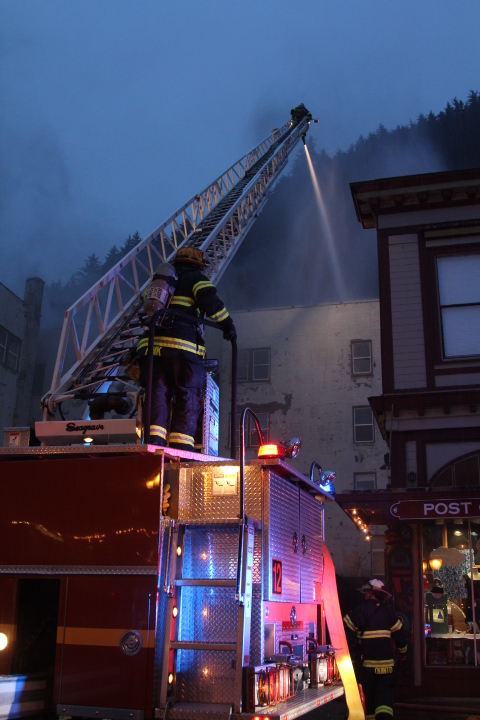 Capital City Fire/Rescue battles Saturday's fire at the Gastineau Apartments building. (Photo by Mikko Wilson/KTOO)