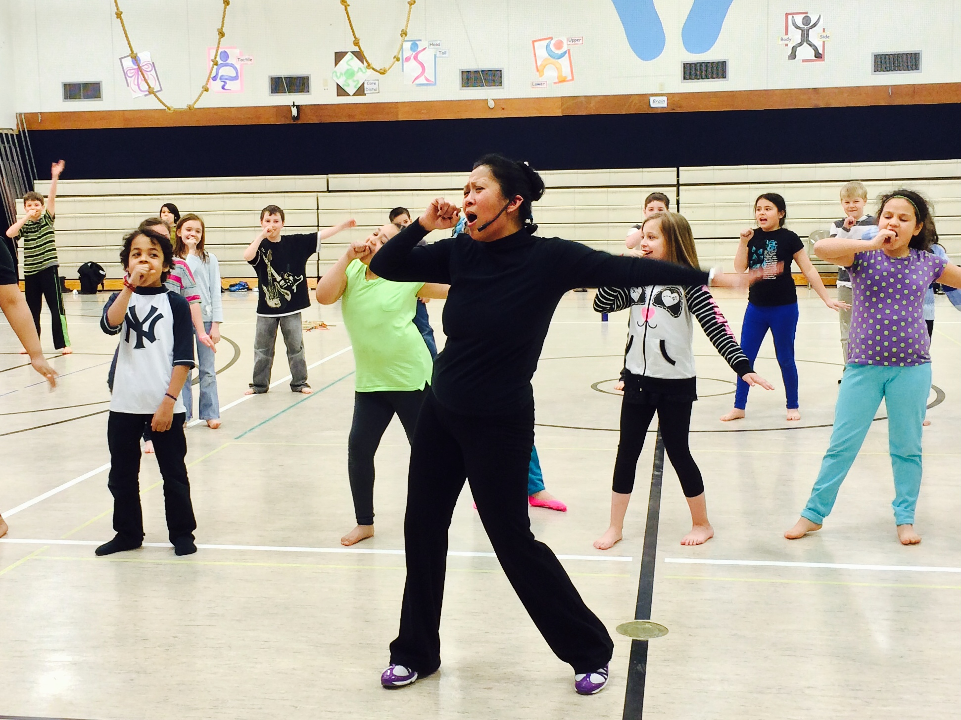 Ricci Adan works with students in the JAMM school musical program. (Photo courtesy Karen Allen)