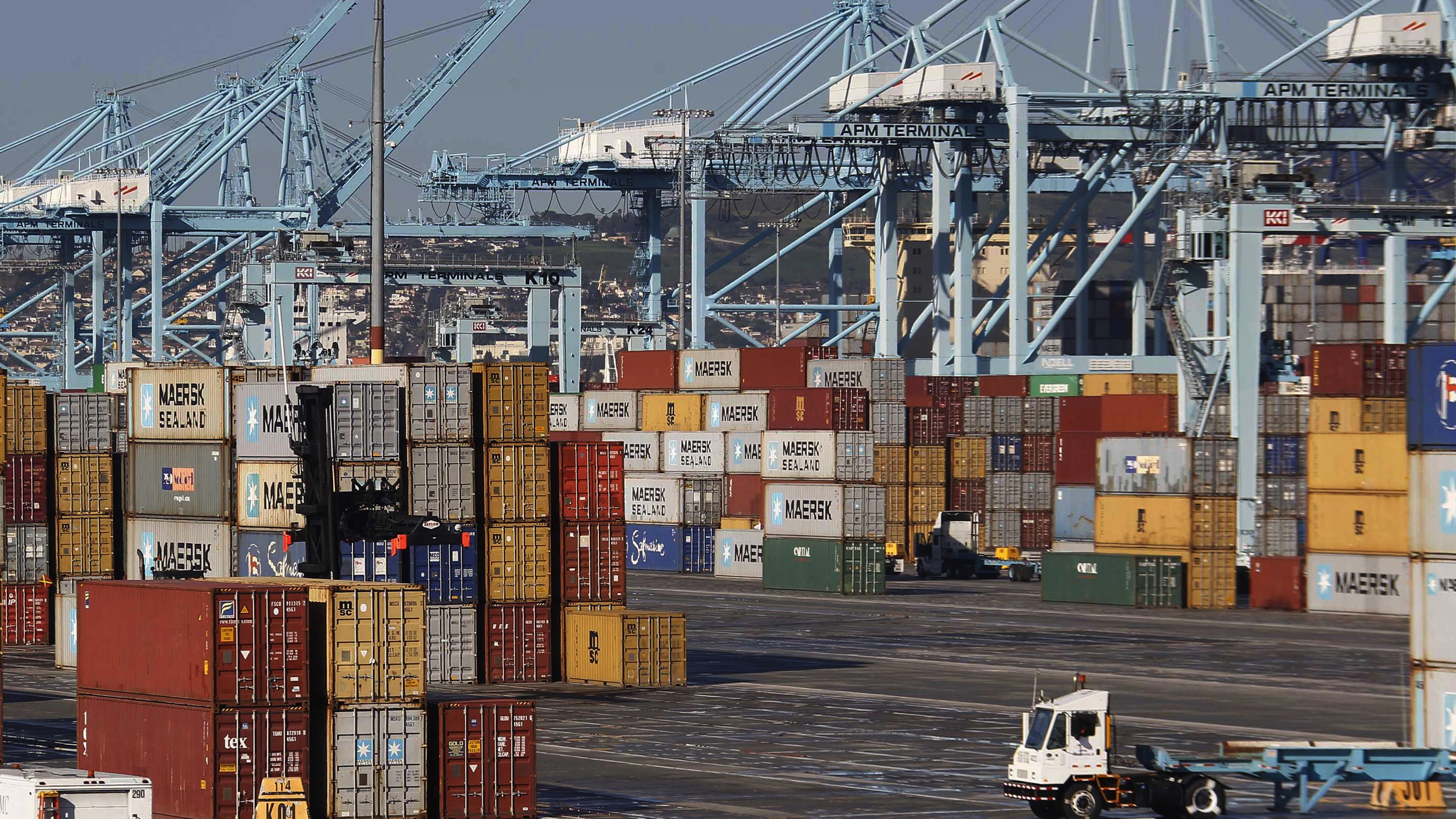 "Shipping containers at the Port of Los Angeles. Unions are stepping up their efforts to thwart White House plans for passing foreign trade deals on a ""fast track"" through Congress. Nick Ut/AP"