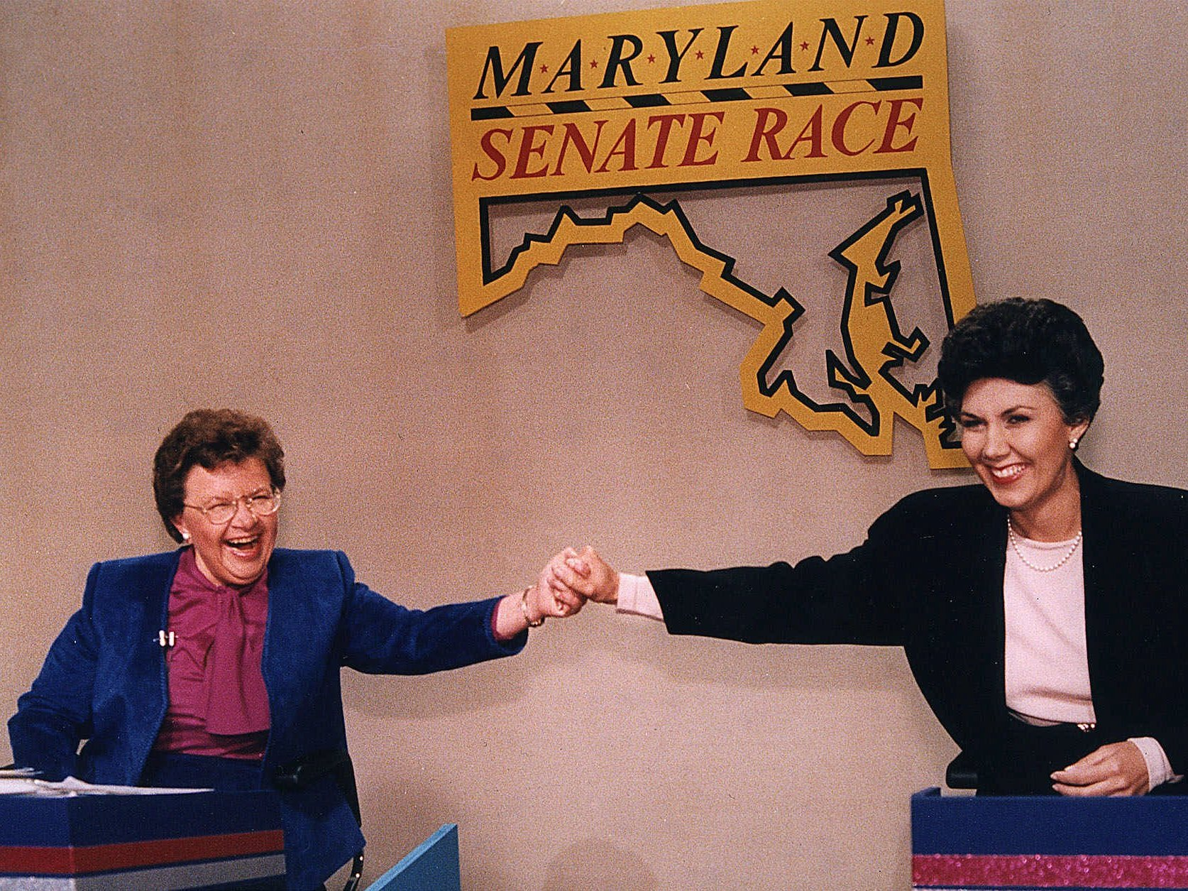 Mikulski, left, and her then-opponent Linda Chavez hold hands before the Maryland Senate candidates debate in 1986. J. Scott Applewhite/AP
