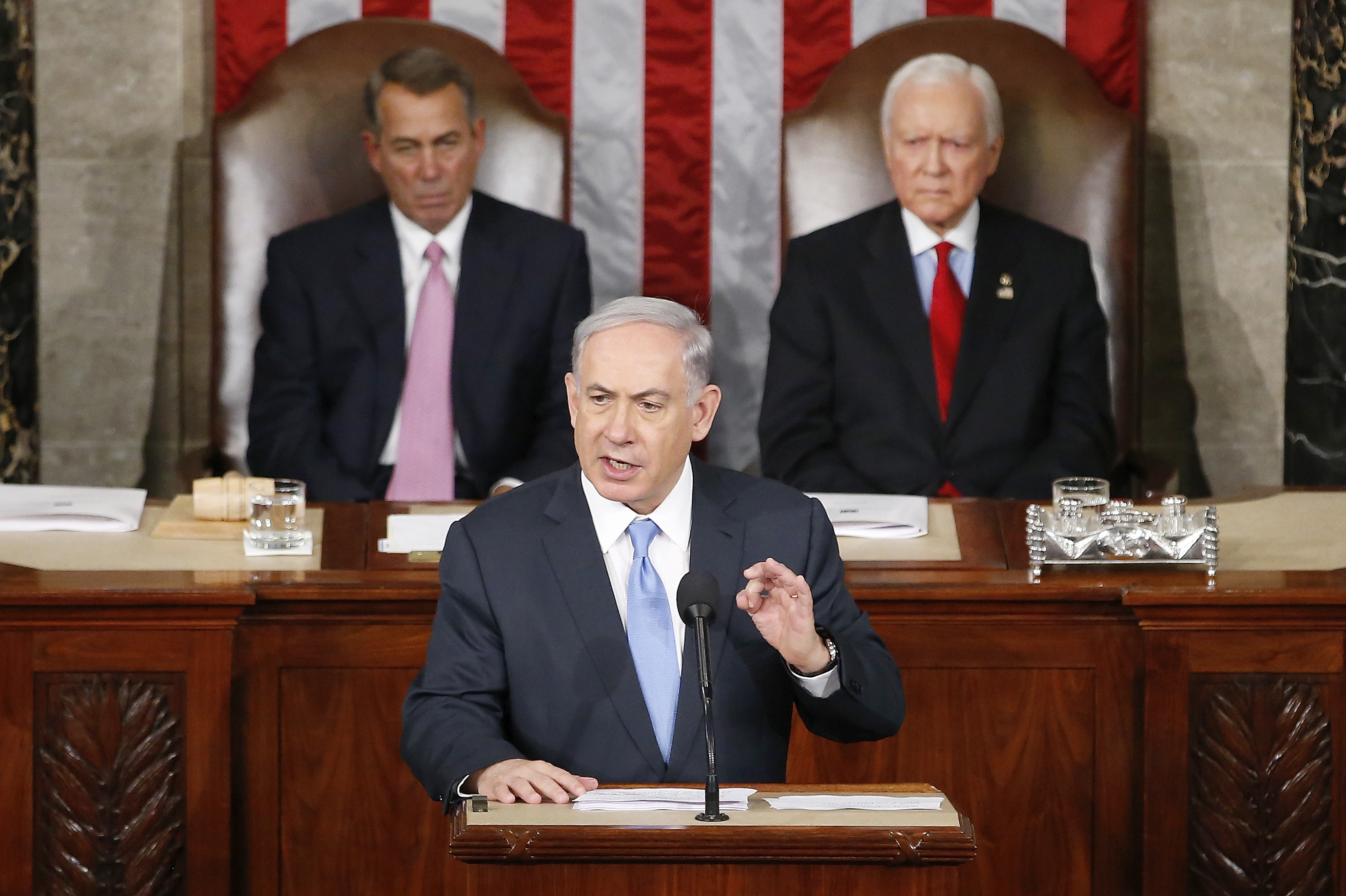 "Israeli Prime Minister Benjamin Netanyahu speaks before a joint meeting of Congress on Capitol Hill in Washington on Tuesday. Netanyahu said the world must unite to ""stop Iran's march of conquest, subjugation and terror."" House Speaker John Boehner of Ohio (left) and Sen. Orrin Hatch, R-Utah, listen. Andrew Harnik/AP"