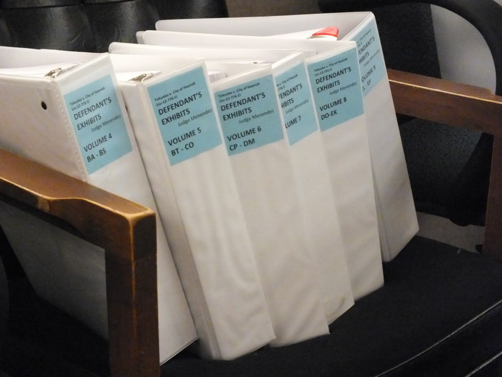 Defendants' trial materials in a chair in the courtroom. (Photo by Matt Miller/KTOO)