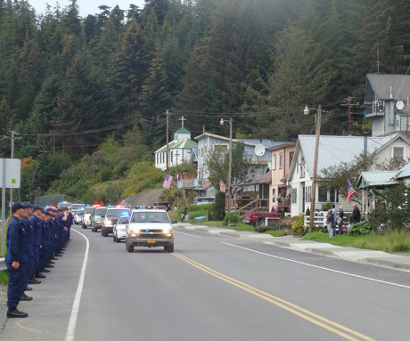 The funeral procession for slain police officers Matt Tokuoka and Tony Wallace moves through downtown Hoonah in September 8, 2010. (Photo by Casey Kelly/KTOO)