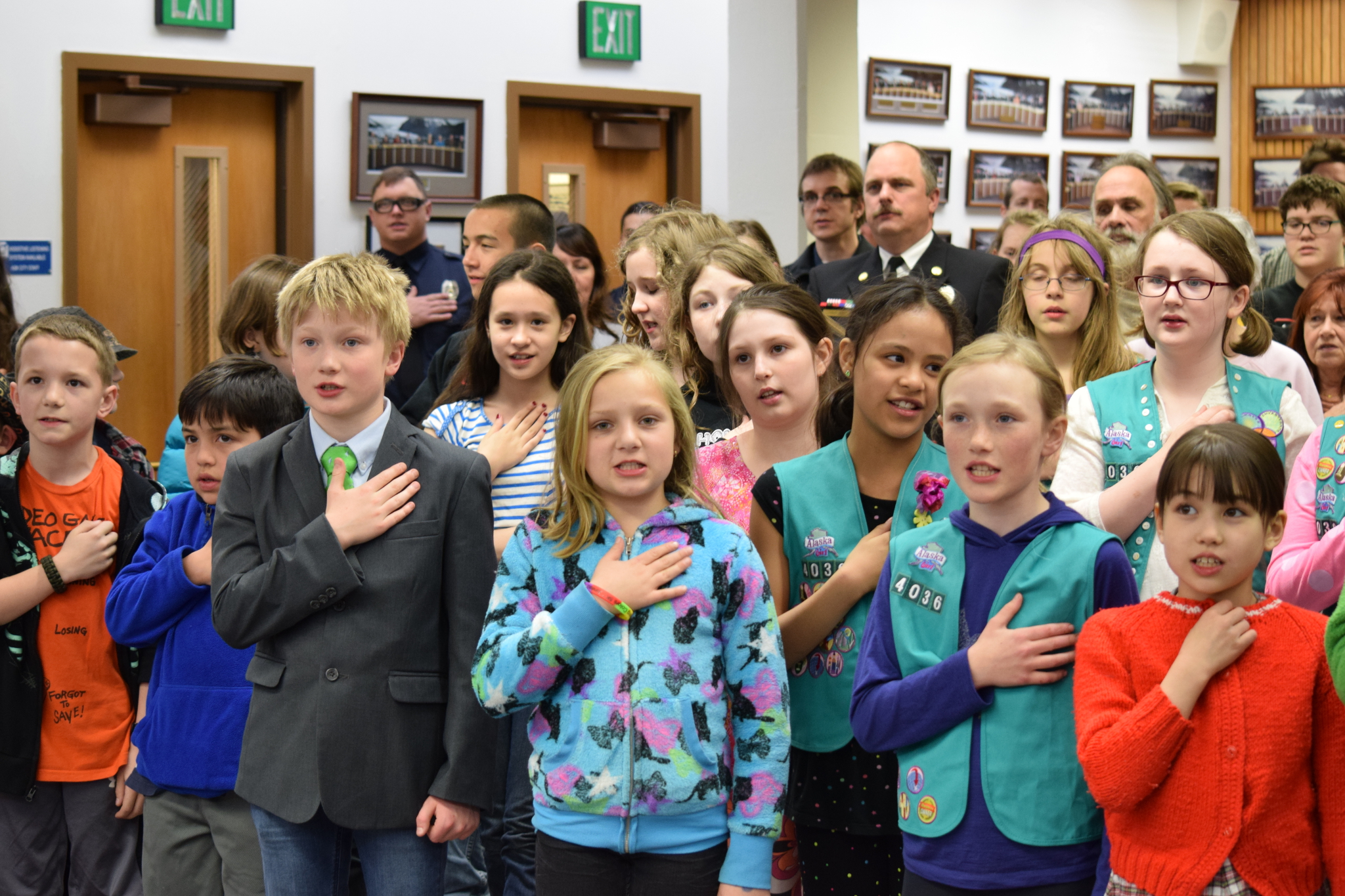 More than 30 Juneau school kids attended Monday's CBJ Assembly meeting to show support for full funding for education. They also led the Assembly in the flag salute before the meeting. (Photo by Casey Kelly/KTOO)