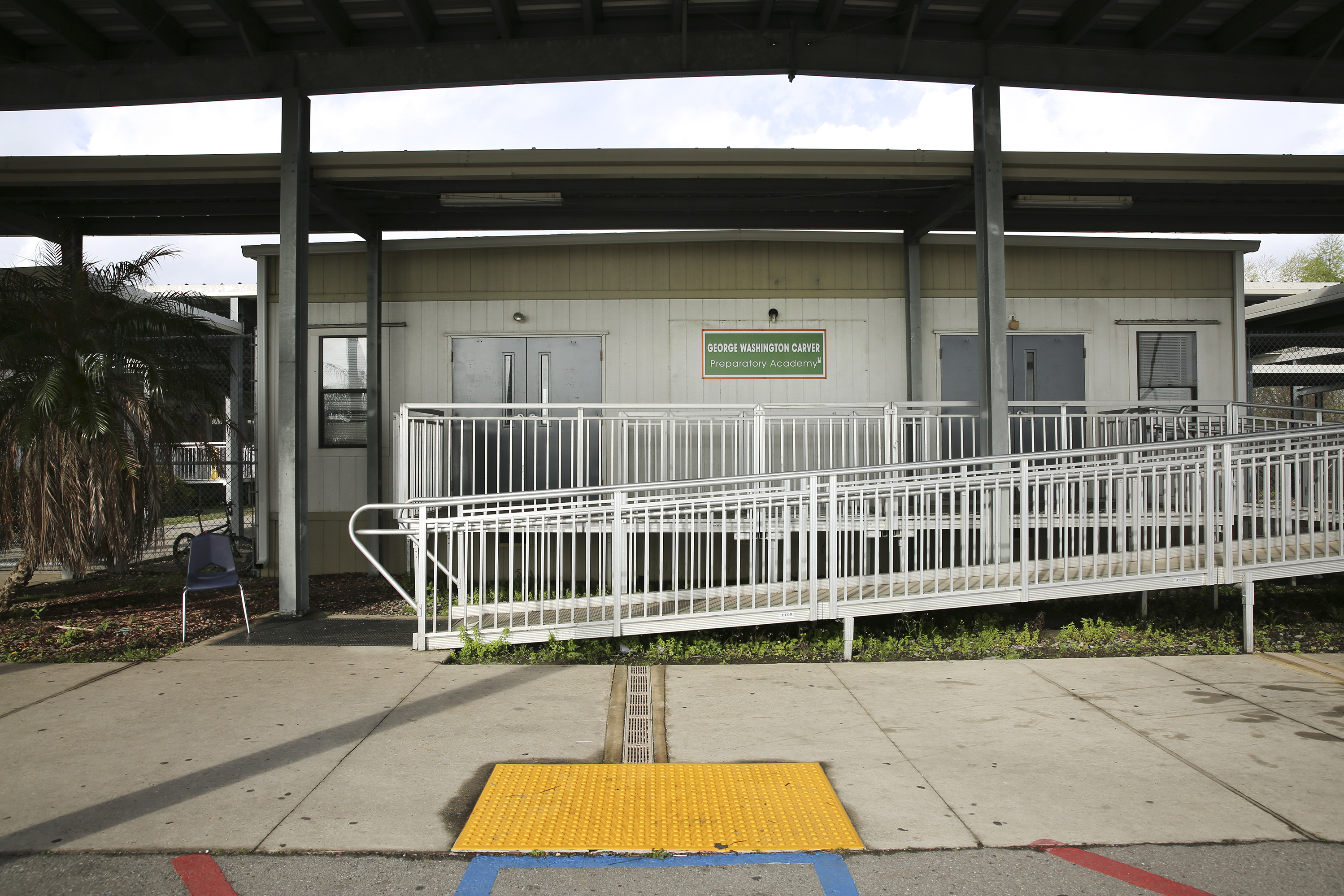 Covered Walkway Construction : A new orleans high school adapts to unaccompanied minors