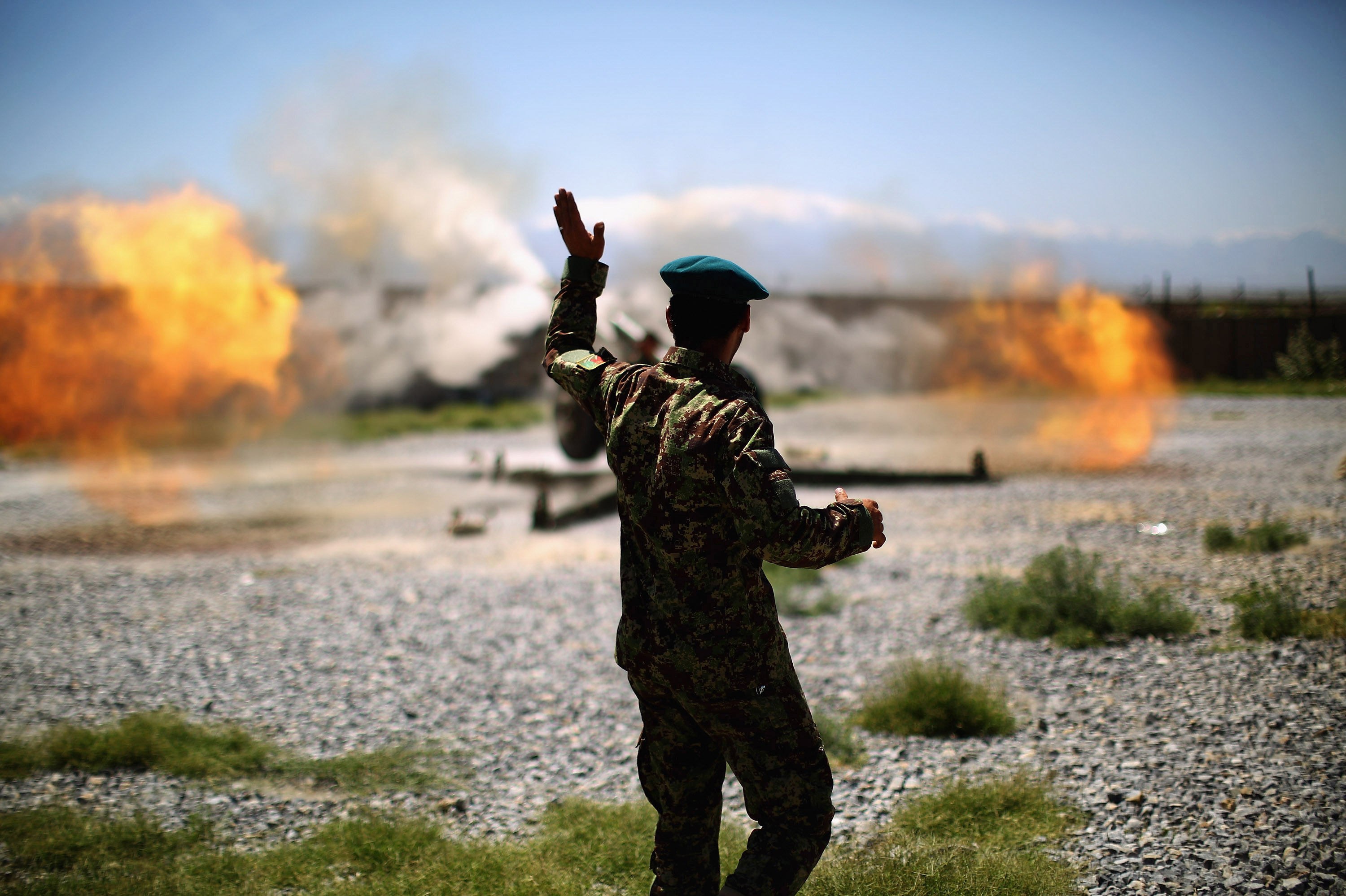 An artillery gun fires a round at Taliban fighters in the hills of Nangahar Province. (Photo by David Gilkey/NPR)