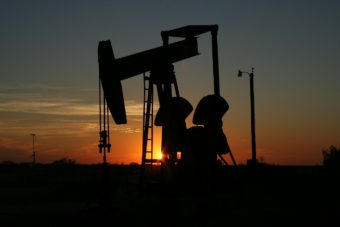 A pump jack at sunset.