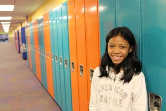 "At 12, Jasmine Molina has found a way to help newly arriving Filipino students transition to middle school. ""She is a self-initiated ambassador,"" says her teacher, Janelle Farvour. (Emily Kwong/KCAW photo)"