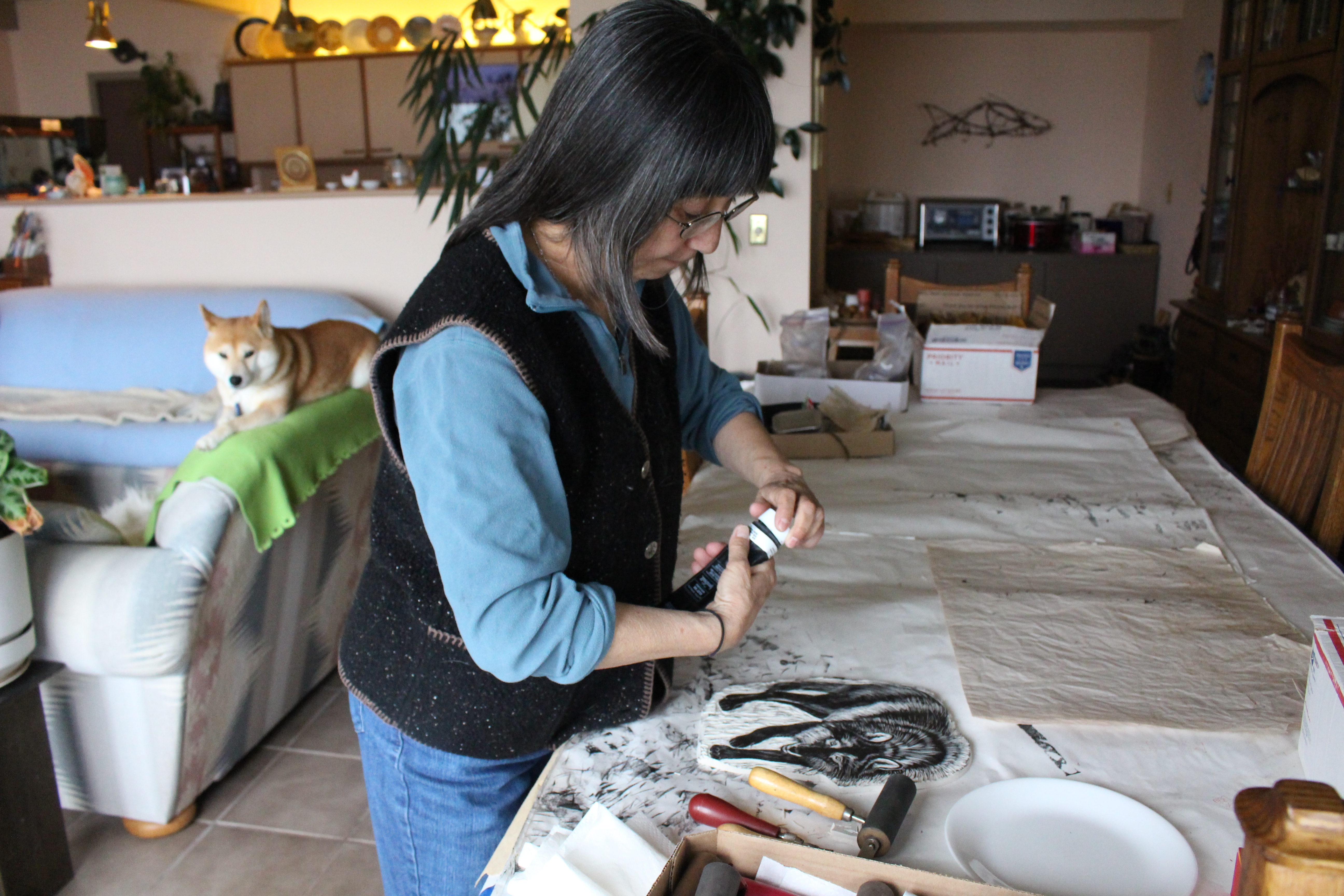 Fumi Matsumoto preps an etched wolf print (photo by Elizabeth Jenkins/KTOO)