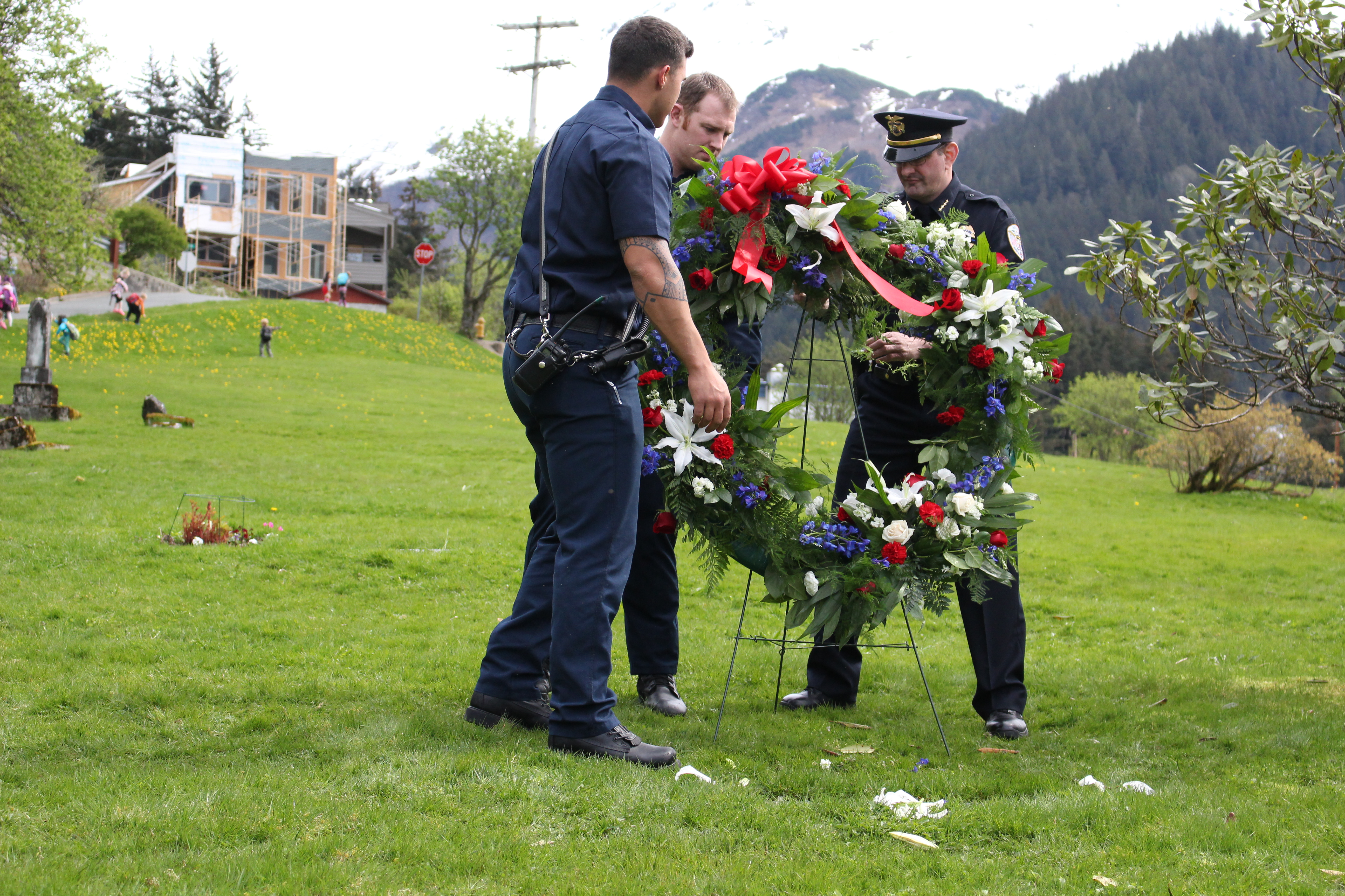 The Juneau Police Department places a wreath on the grave of Officer Richard Adair. (Photo by Elizabeth Jenkins/KTOO)