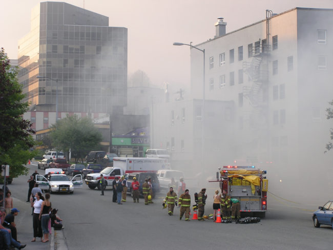 Smoke fills the streets of downtown Juneau as the historic Skinner Building burns, Aug. 15, 2004.  (Creative Commons photo by Gillfoto)