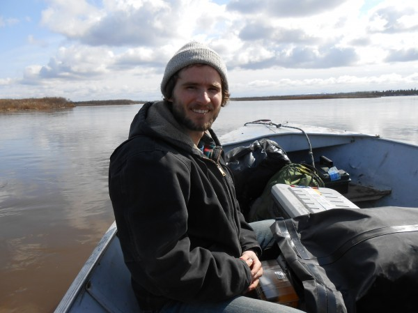 Sean Brennan doing research on the Nushagak River. (Photo courtesy of UAF)