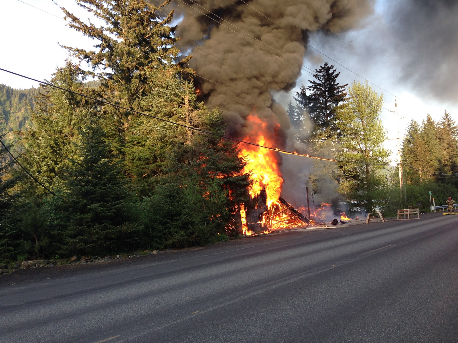 A structure fire along  North Douglas Highway near mile 3, May 14, 2015. (Photo by Casey Kelly/KTOO)