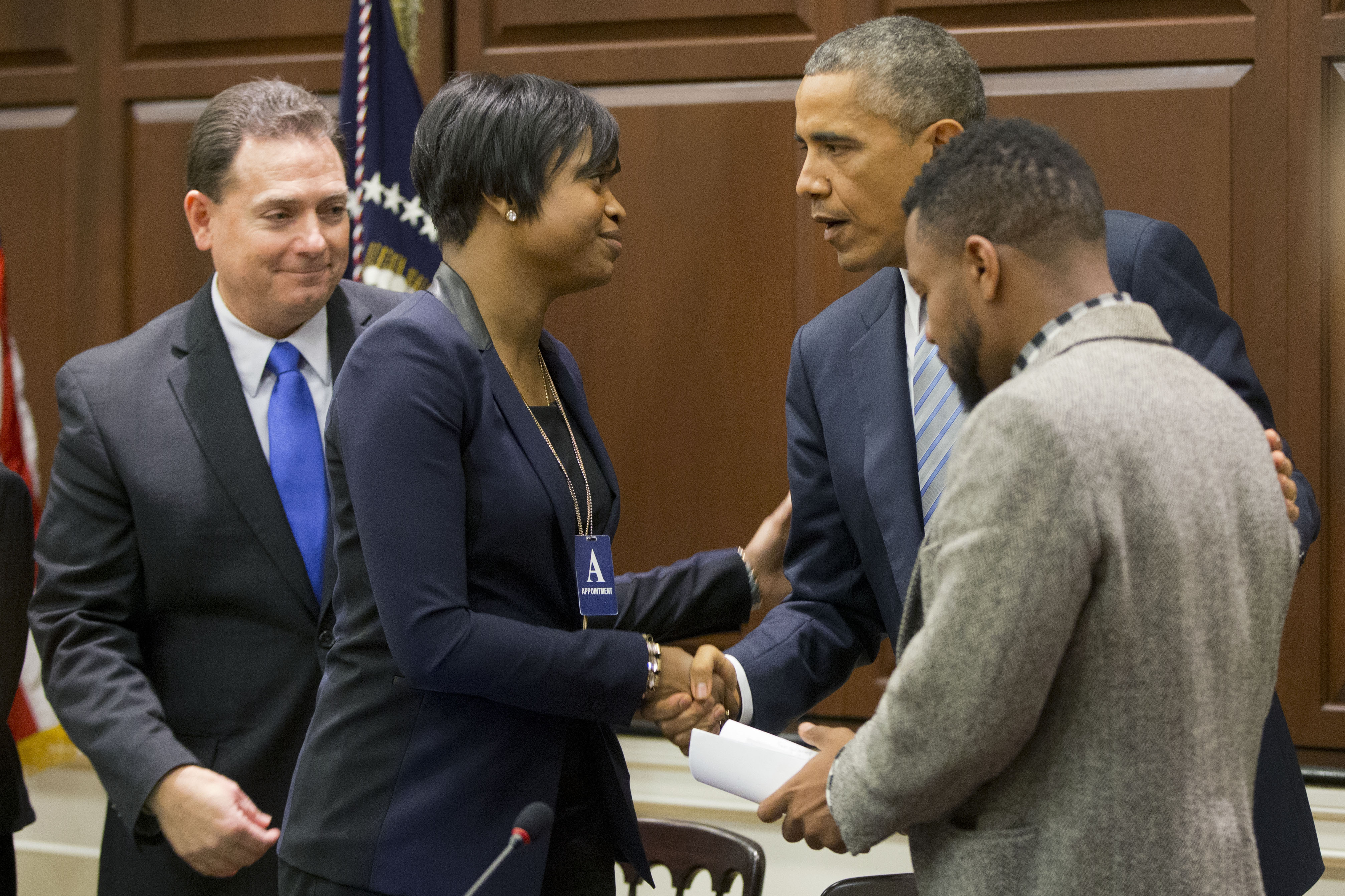President Obama greets Brittany Packnett, the executive director of Teach for America in St. Louis, last December.