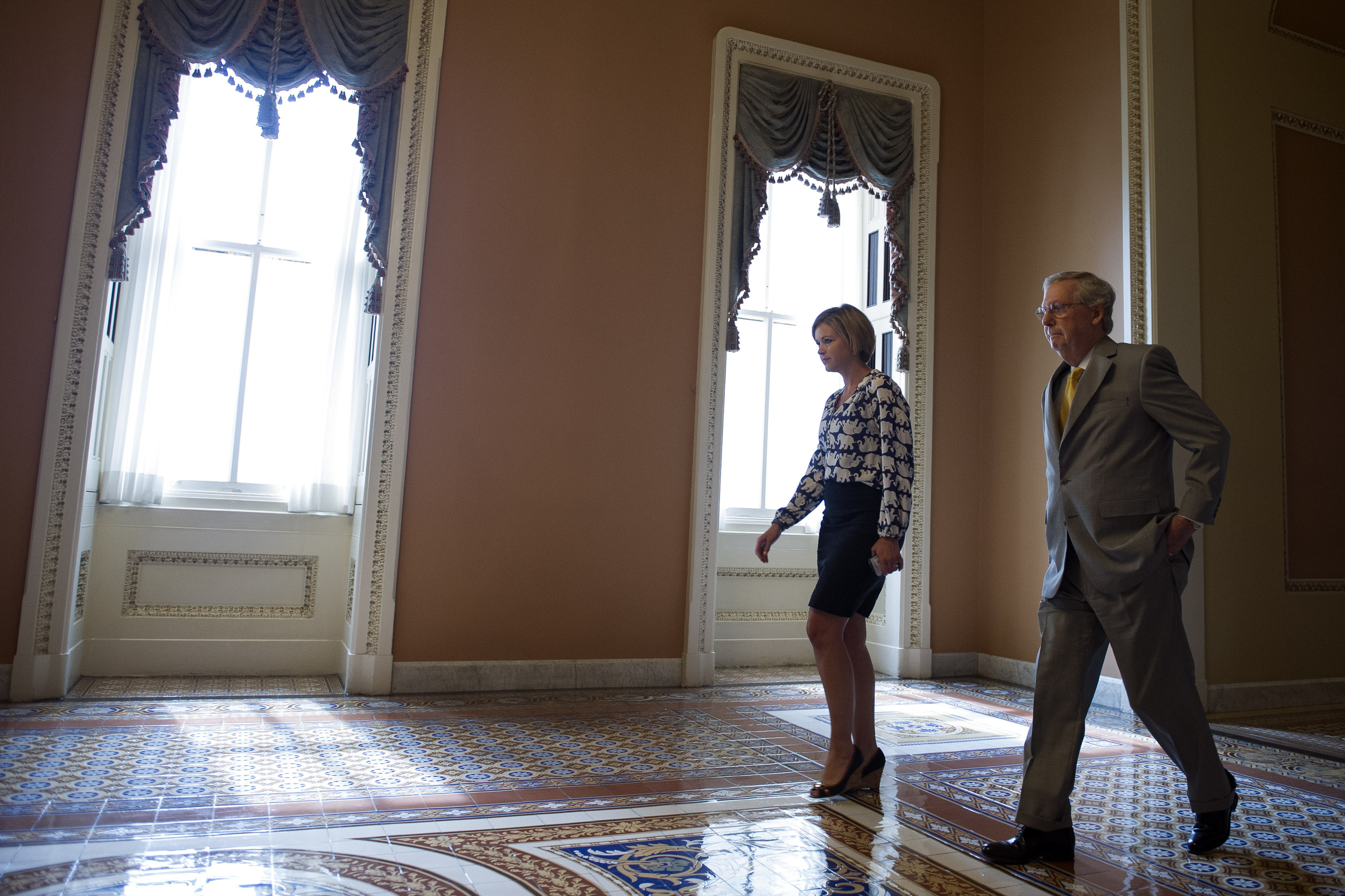 Senate Majority Leader Mitch McConnell, R-Ky., walks from the Senate Chamber after opening a special session to extend surveillance programs in Washington, on Sunday. Cliff Owen/AP