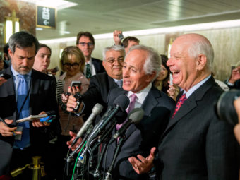 Senate Foreign Relations Committee Chairman Sen. Bob Corker, R-Tenn., center, and the committee's ranking member Sen. Ben Cardin, D-Md., right, were all smiles April 14 after the committee passed an agreement on oversight of Iran negotiations. But the bill has run into some outspoken opponents in the full Senate. (Photo by Andrew Harnik/AP)