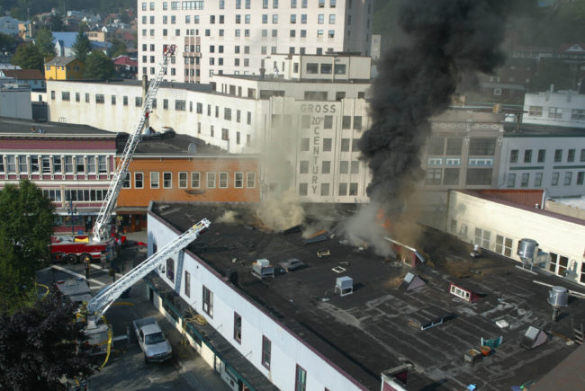 Firefighters tried to cut a hole into the roof of 2004 Skinner Building fire to relieve let the heat and smoke buildup, but they encountered multiple layers of roofs that had been added over the years. (Photo by Brian Wallace) (Photo by Brian Wallace)