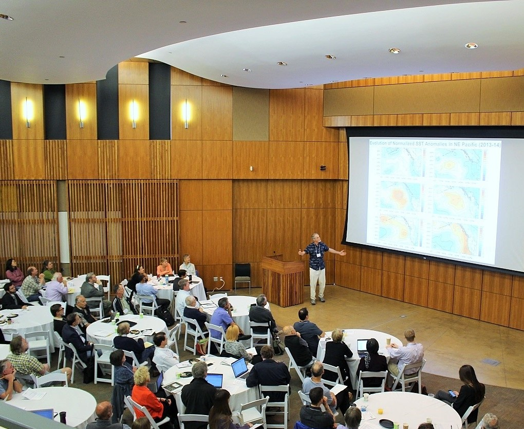 Washington state climatologist Nicholas Bond (on stage) presents his observations on warm sea surface temperatures during a May 2015 conference at Scripps Institution of Oceanography. (Photo  courtesy of Southern California Coastal Ocean Observing System)