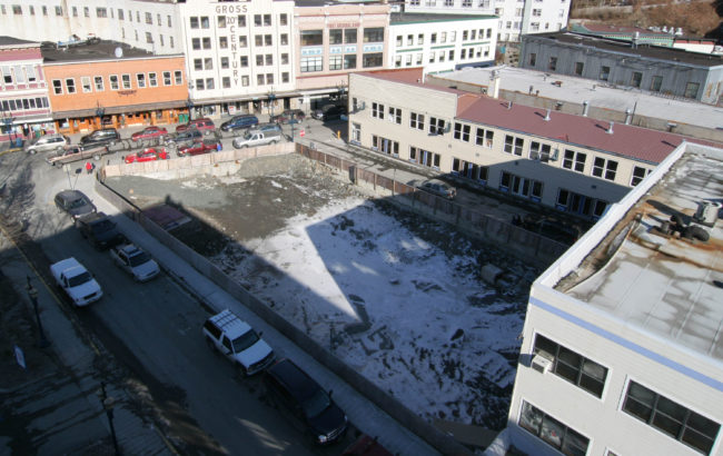 "By the end of 2004, the debris from the Skinner Building fire had been cleared to below street level, creating ""the pit."" (Photo by Brian Wallace)"