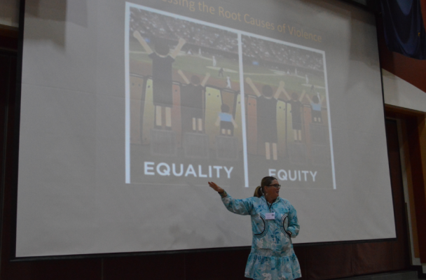 "Timi Tullis discusses the one of the root causes of violence—explaining why we need to work toward ""equity"" rather than simply ""equality."" (Photo by Jenn Ruckel/KNOM)"