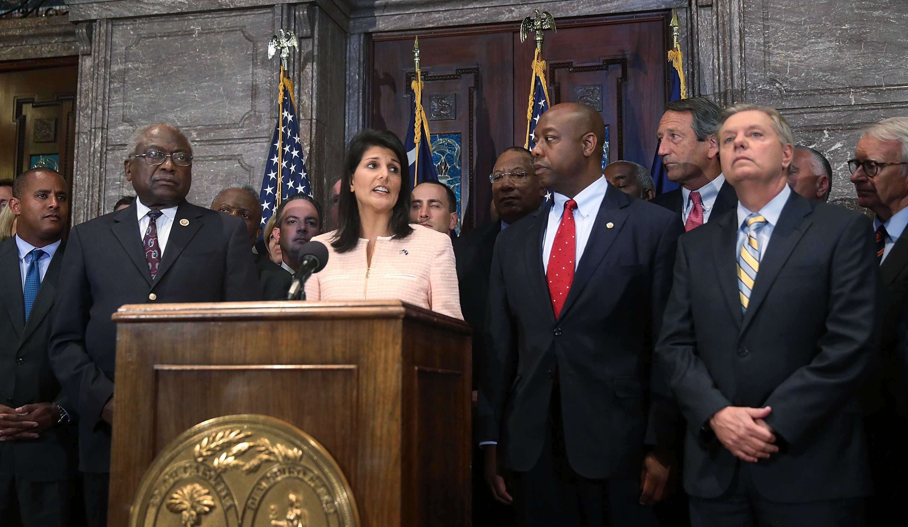 In June, South Carolina Gov. Nikki Haley along with Sens. Tim Scott and Lindsey Graham (right, far right) and other lawmakers and activists called for the Confederate flag to be moved from state Capitol grounds. Joe Raedle/Getty Images