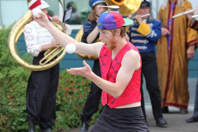 """A New Old Time Chautauqua performer juggling in the streets of Wrangell, June 26, 2015. (Photo by Zachary """"Skip"""" Waddell/New Old Time Chautauqua)"""