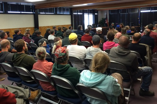 About 70 people gathered in Sitka's Harrigan Centennial Hall to hear from Dale Kelley, of the Alaska Trollers Association. (Photo by Rachel Waldholz/KCAW)