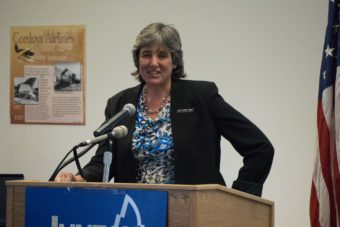 Office of Management and Budget Director Pat Pitney addresses the Juneau Chamber of Commerce, July 16, 2015.