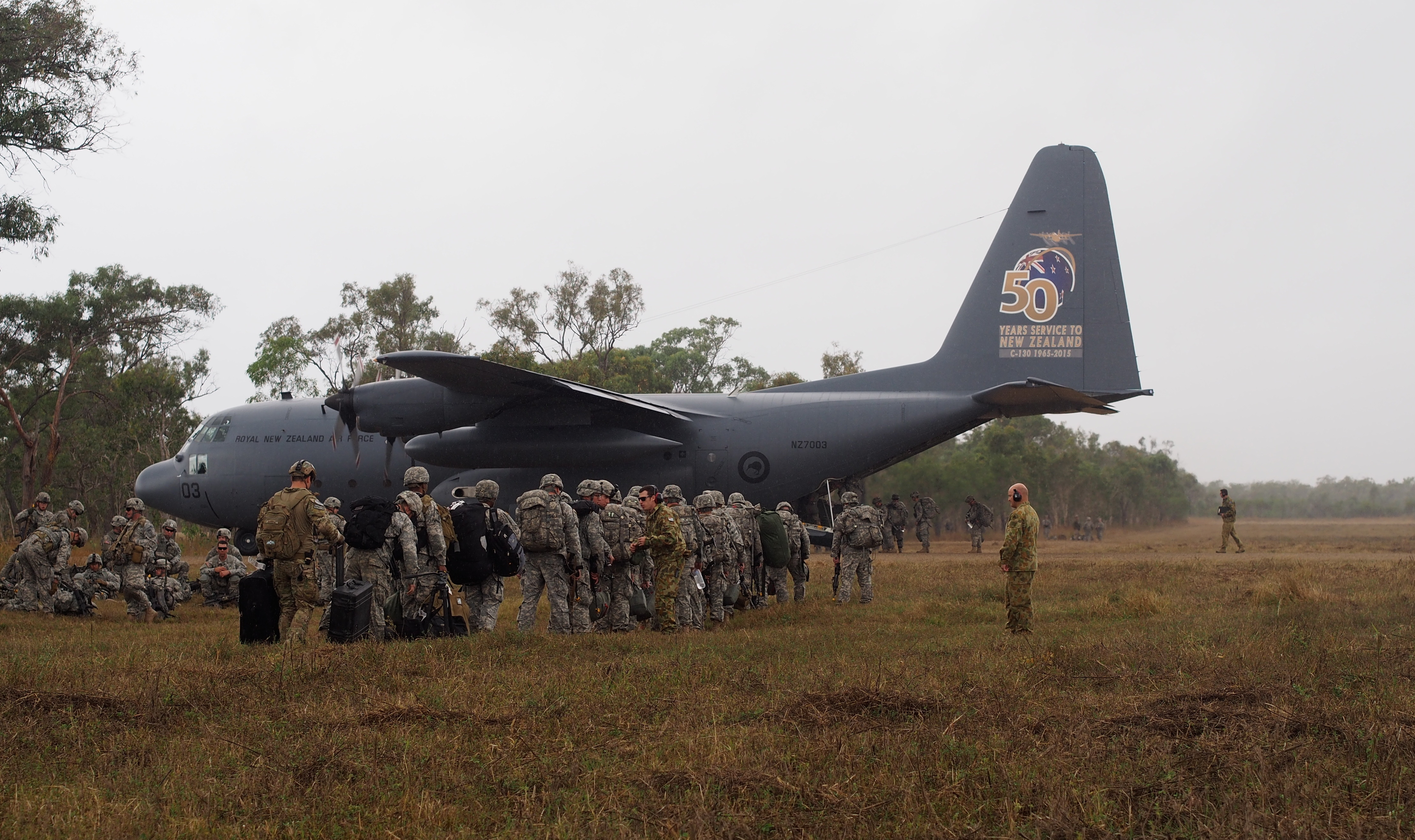 Members of the 4/25th Airborne Brigade of JBER load up on a C-130 during exercise Talisman-Saber. (Photo by Zachariah Hughes/KSKA)