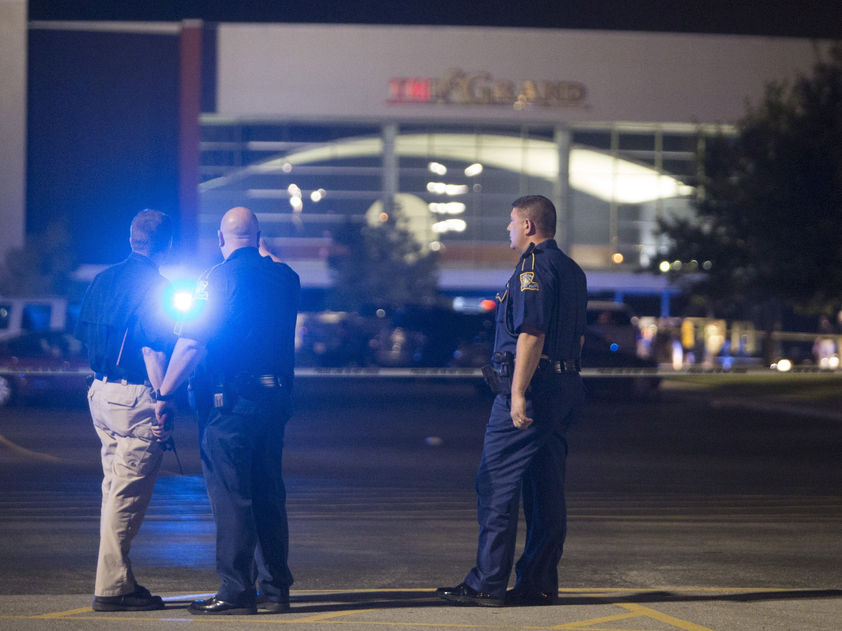 Officials stand by the scene outside a movie theater where a man opened fire on filmgoers Thursday in Lafayette, La. At least two were fatally wounded and seven others injured before the gunman killed himself. Lee Celano/Reuter