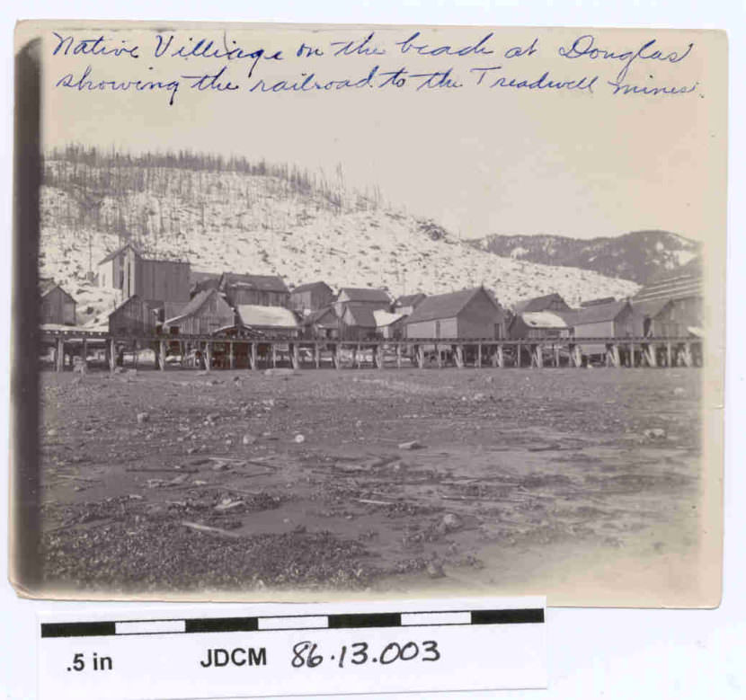 This photo shows the Douglas Indian Village and railroad to the Treadwell mines in 1900.