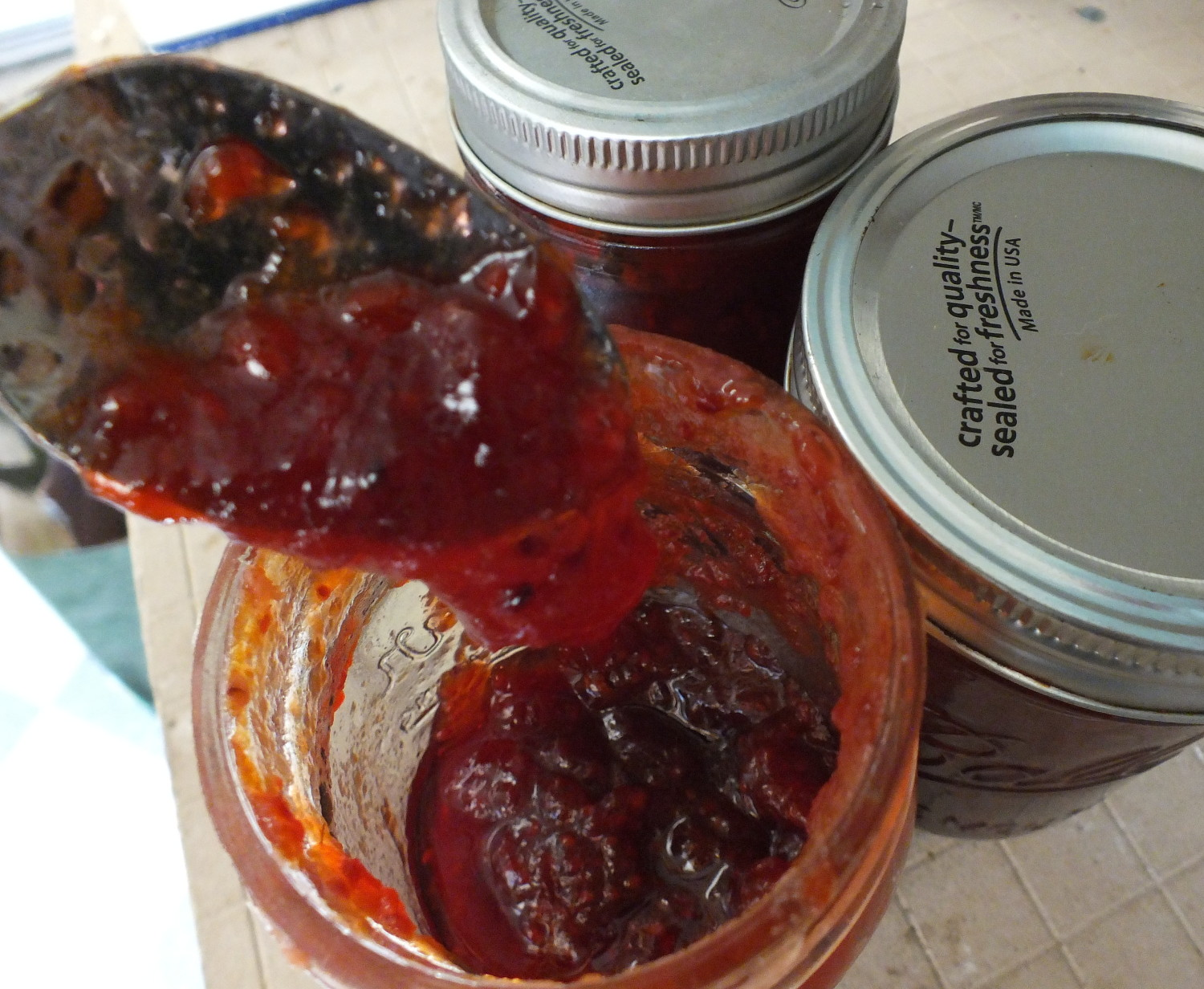 Yum! Fresh homemade salmonberry jam is delicious! (Photo by Matt Miller/KTOO)