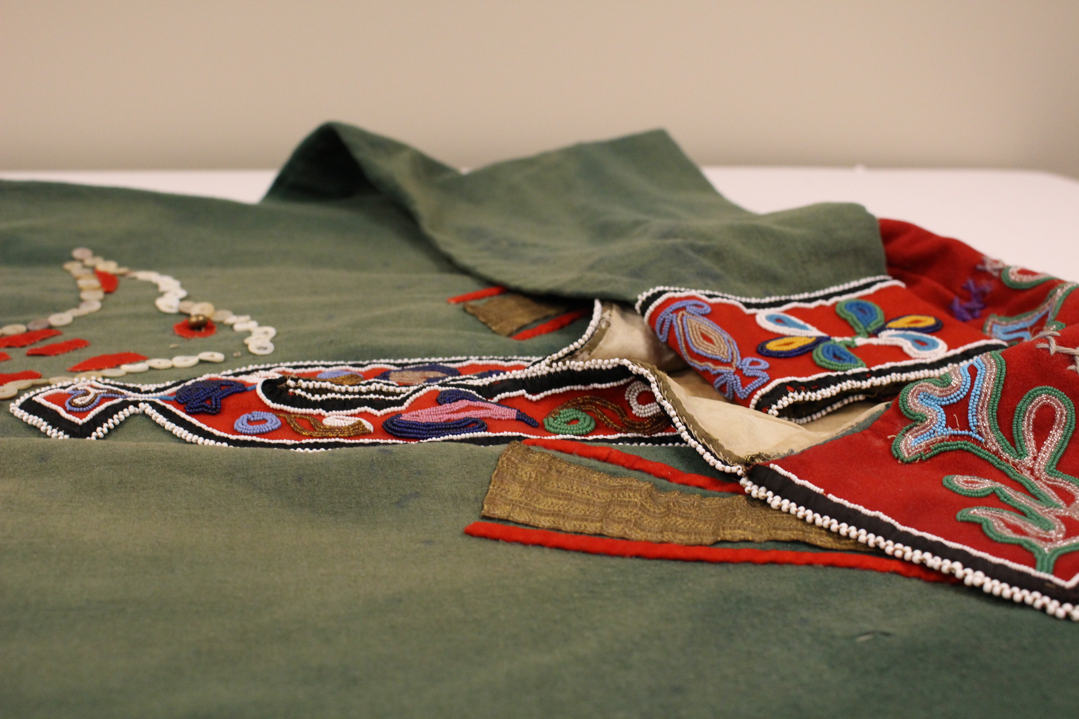 This tunic was repatriated from a museum in 2007. Although it's of Southeast origin, the tribe is unknown.  (Photo by Elizabeth Jenkins/KTOO)