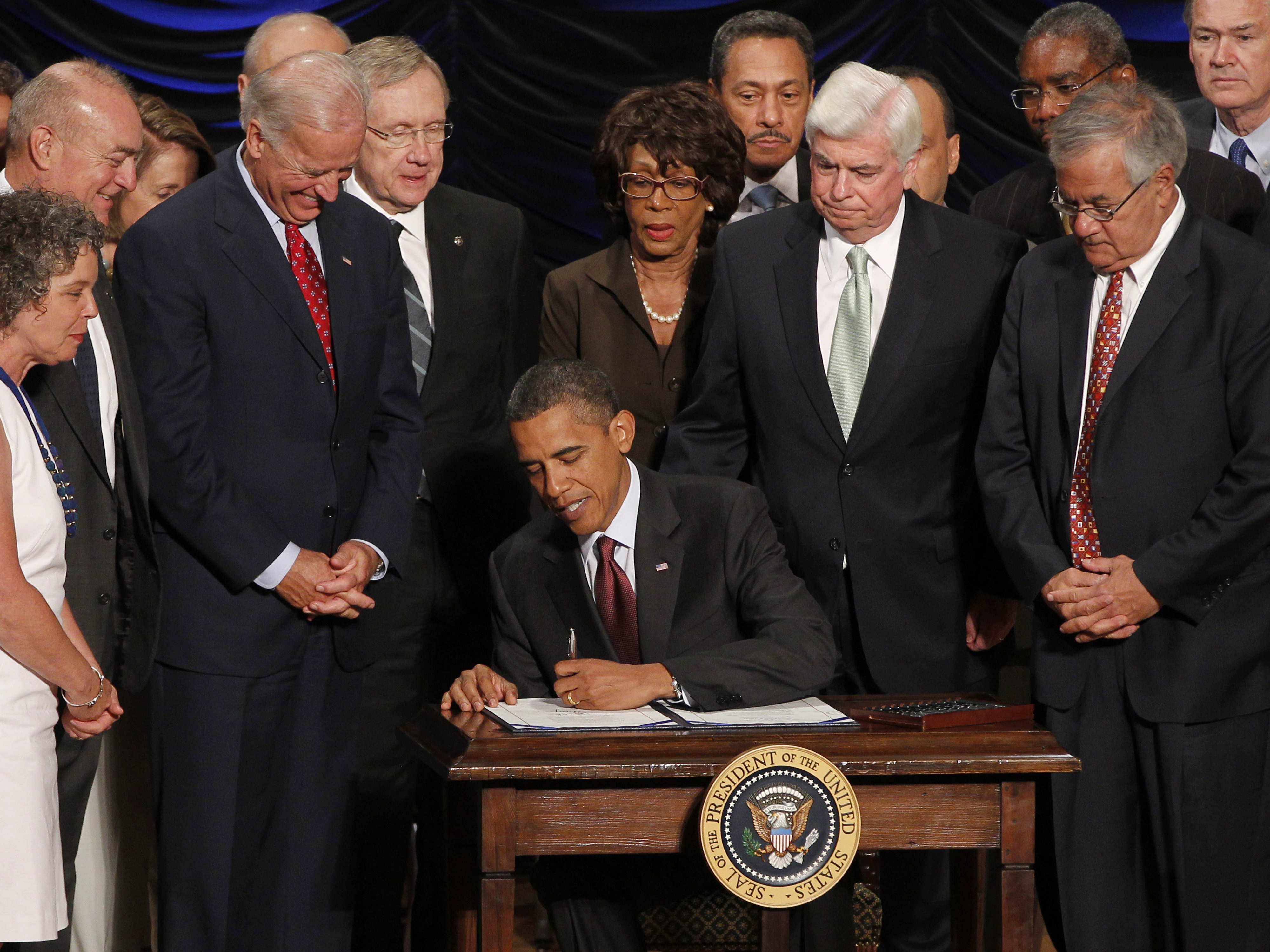 President Obama signs the Dodd-Frank financial overhaul bill in Washington on July 21, 2010. Five years later, debate over the effectiveness of the legislation continues. Charles Dharapak/AP