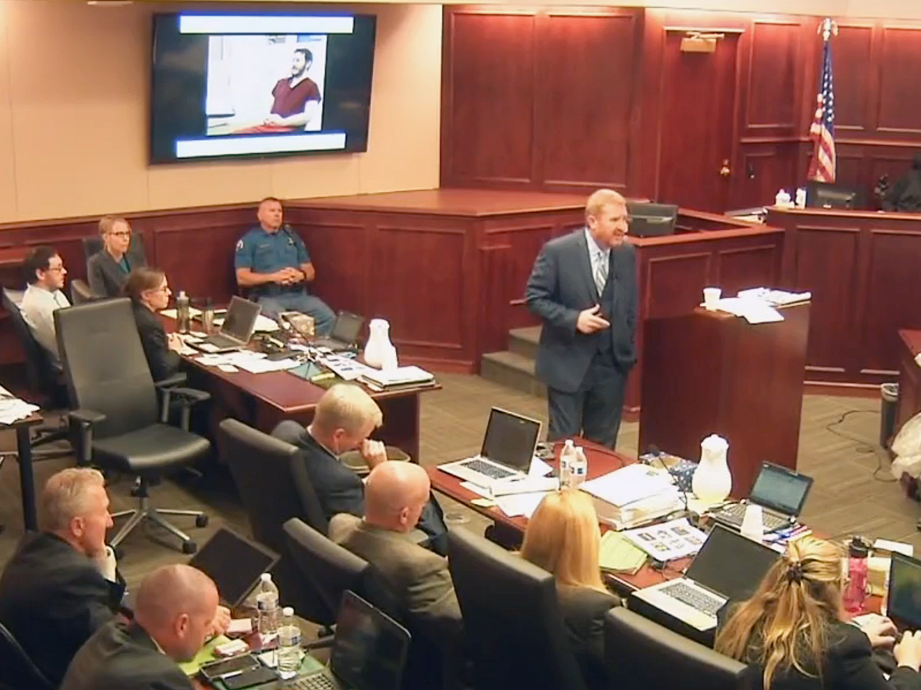 In this image taken from video, James Holmes (upper far left) listens to defense attorney Daniel King give closing arguments during Holmes' trial in Centennial, Colo., on Tuesday. Holmes was found guilty Thursday of first-degree murder in the deaths of 12 people at a Colorado theater. Colorado Judicial Department /AP