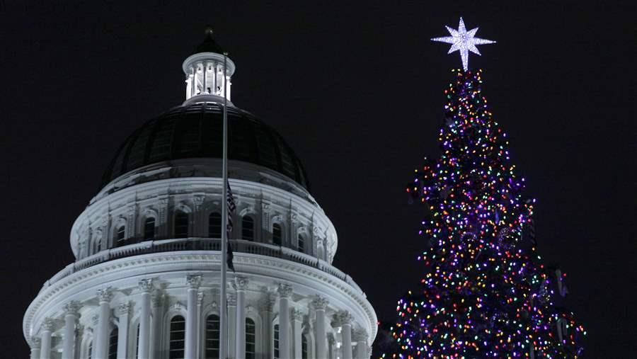 California's state Christmas tree shines from 10,000 ultra-low-wattage LED bulbs. State agencies routinely are told to meet energy-saving targets. Whether they do is often hard to determine. AP