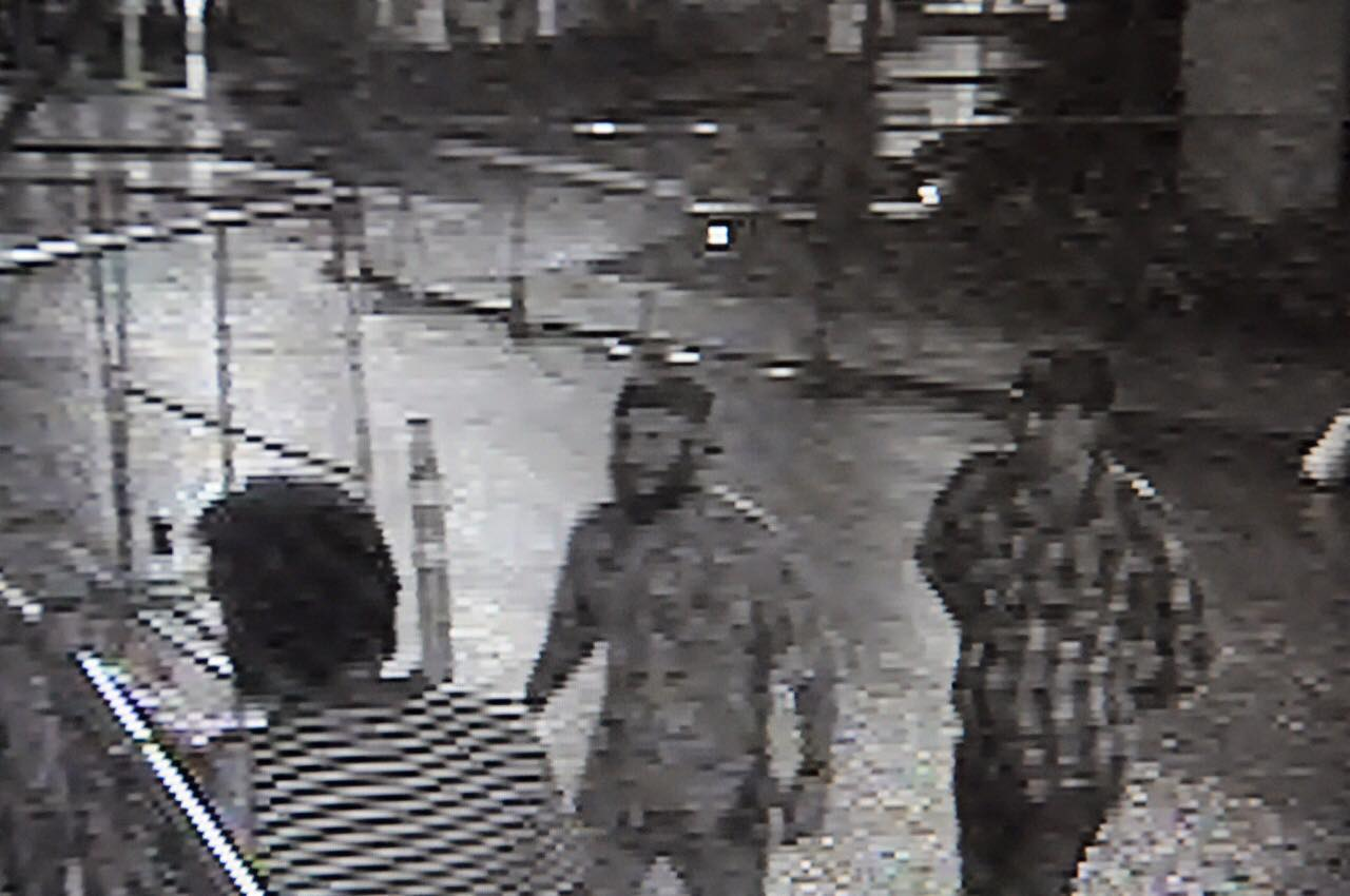 A video still of the three men that Capitol building security suspects scaled the Capitol to steal rooftop flags.