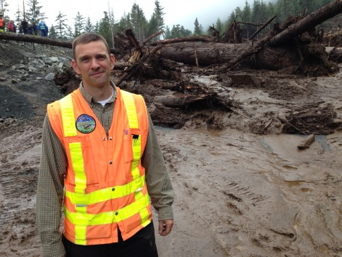 """City engineer David Longtin is back working at the landslide that nearly overtook him Tuesday. Longtin is not totally at ease — """"I'm keeping my eye on it,"""" he says. (Photo by Robert Woolsey/KCAW)"""
