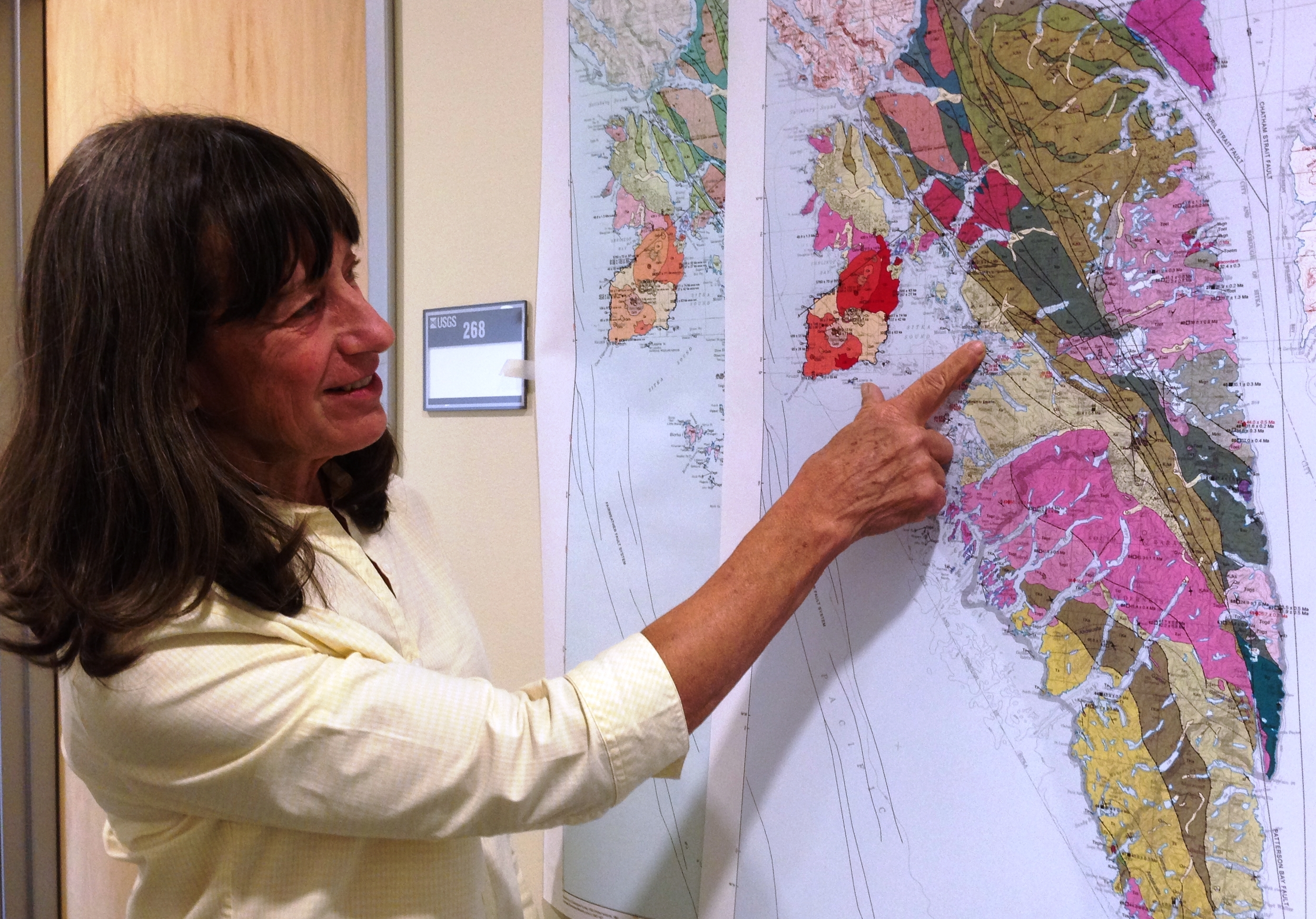 Susan Karl points to fauls shown on a new geologic map of Baranof Island, in Southeast Alaska. It reflects the discovery that the island's bedrock is different from that of other parts of the region. (Ed Schoenfeld/CoastAlaska News)