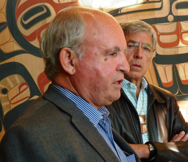 B.C. Minister of Mines Bill Bennett, left, discusses his trip up the Taku River with Lt. Gov. Byron Mallott, right, in the Walter Soboleff Center lobby Aug. 24 in Juneau. (Photo by Ed Schoenfeld/CoastAlaska News)
