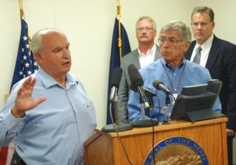 8-26-15 B.C. Mines Minister Bill Bennett discusses the week's mine meetings as Lt. Gov. Byron Mallott and other state officials listen during a Wednesday press conference. (Photo by Ed Schoenfeld, CoastAlaska News)