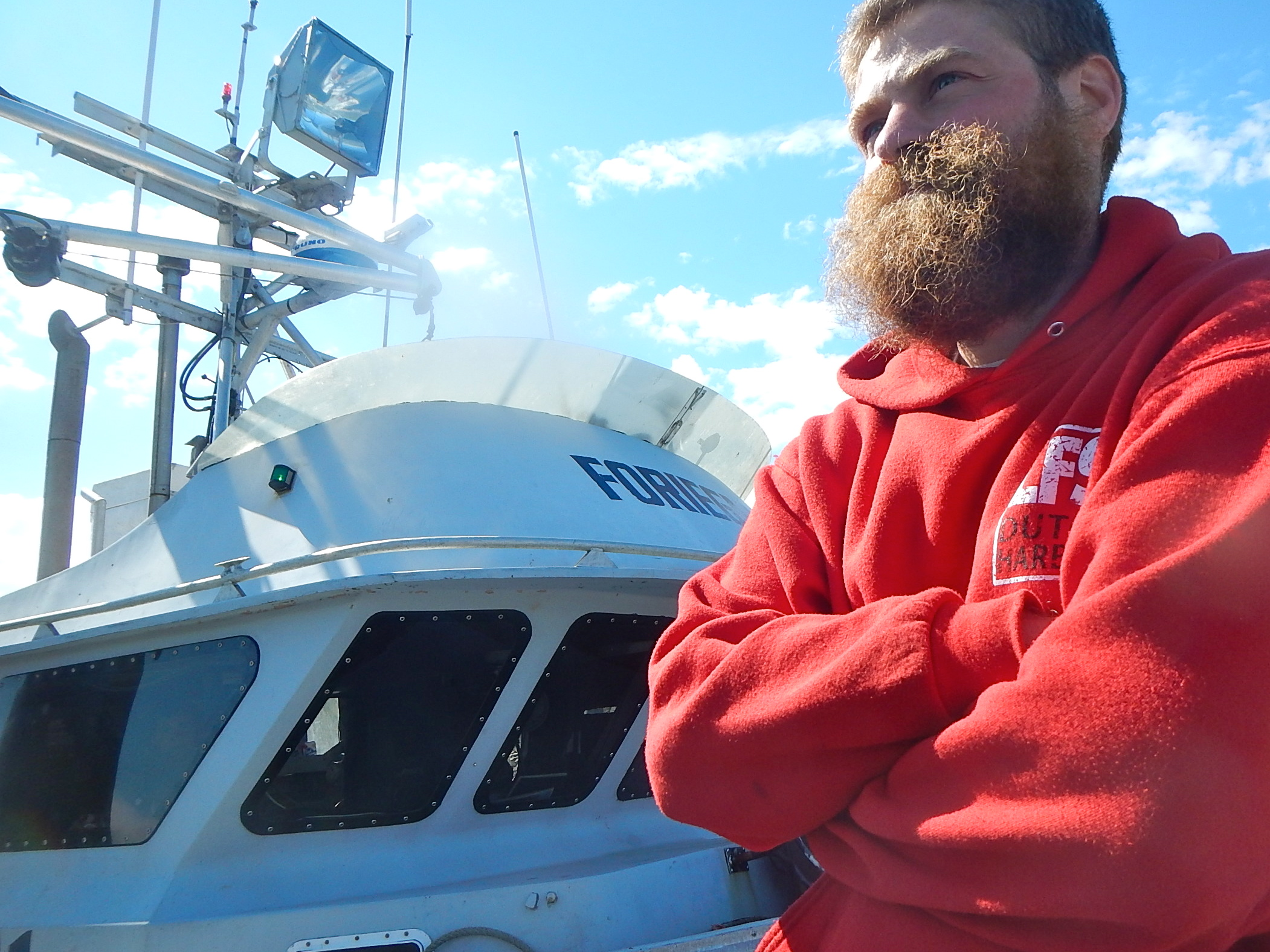 Mihey Basargin of Wasilla on the docks in Dutch Harbor after being rescued. (Photo by John Ryan/KUCB)