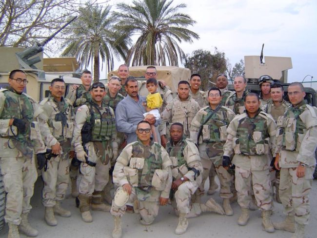 Joseph Murphy (from left, first man kneeling) served in the Iraq War. The squad was led by Ed Irizarry (standing to the left above Murphy). Mike Mercer (far right) was a gunner with Murphy. (Photo courtesy Ed Irizarry)