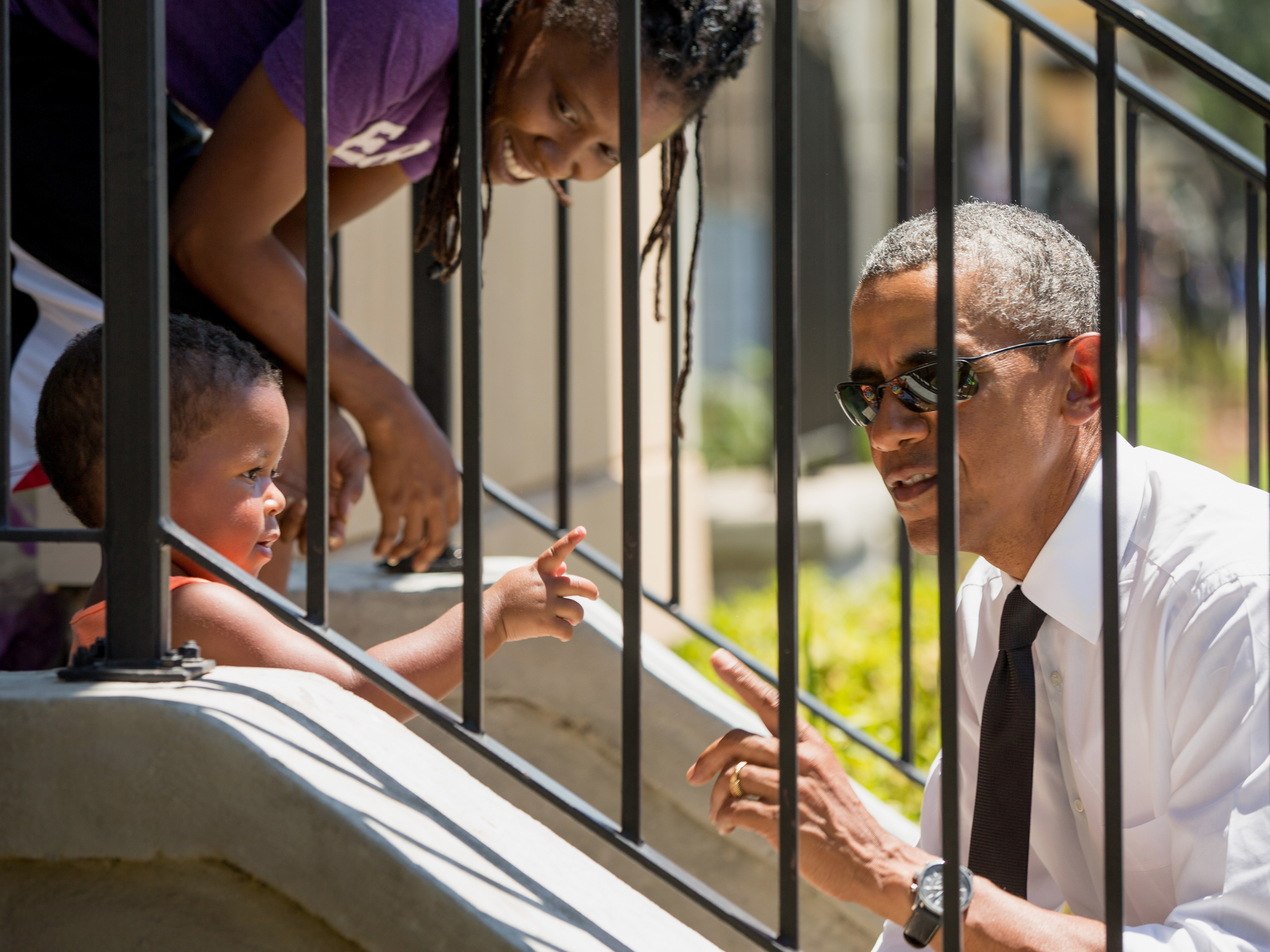 President Obama greets residents in New Orleans on Thursday while in town to mark 10 years since Hurricane Katrina. Andrew Harnik/AP